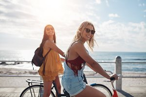 Two female friends riding bikes