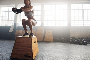 Fitness woman doing box jump