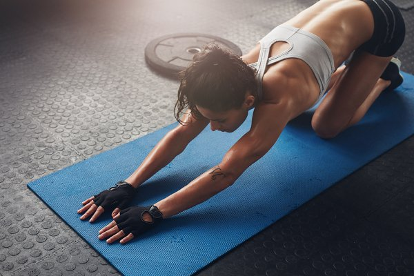 Woman on fitness mat