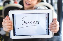 woman showing success sign