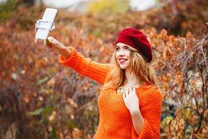Hipster girl doing self-portrait