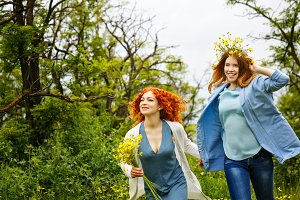 Girlfriends walking in the park.