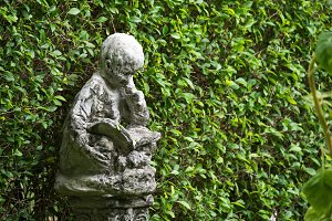 statues in green garden