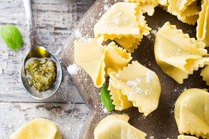 Homemade raw Italian saccottini with green pesto