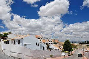 white houses, blue sky and clouds
