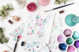 Workspace with watercolor paintings