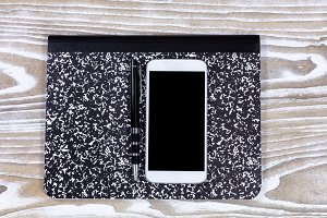 Notepad with pen and cellphone