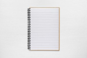 Notepad on white table
