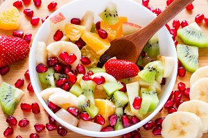 chopped fruit with a wooden spoon