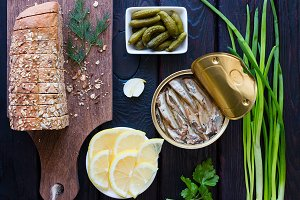 bread with grains, gherkins, sprats