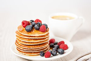 Stack of pancakes with berries breakfast