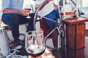 Woman having red wine on the boat