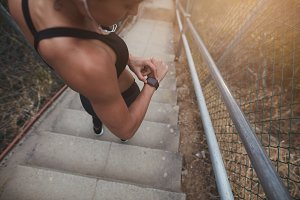 Woman using smartwatch for exercise