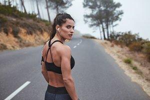 Female runner on country road