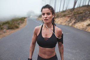 Muscular woman in sportswear