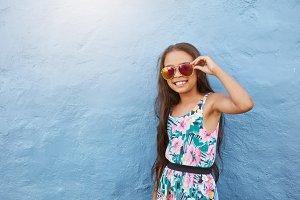 Stylish little girl with sunglasses