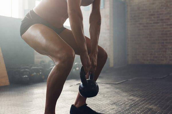 Muscular young woman exercising