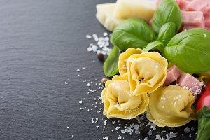 Homemade raw Italian tortellini with ham and cheese