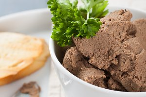 Healthy chicken liver pate with parsley in bawl
