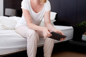 Mature woman with a digital tablet