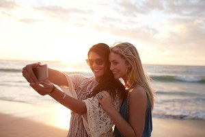 Happy young women taking selfie