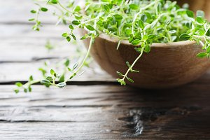 Green thyme on the wooden table