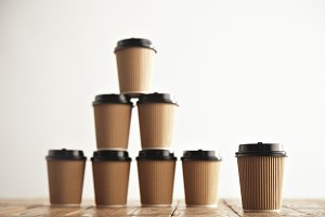 Brown cardboard take away paper cups with black caps set