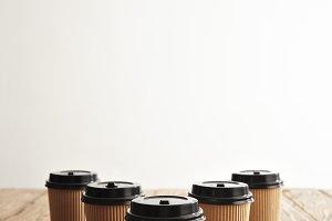 Brown cardboard take away paper cups with black caps set
