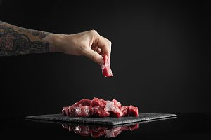 Meat slice isolated on black cooking set