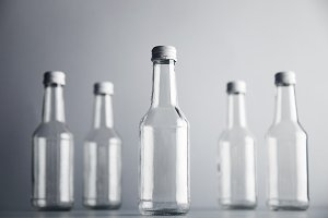 Empty glass cocoktail bottle with white cap mockup set