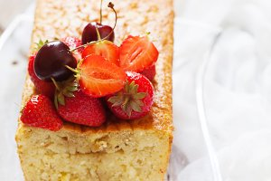 Fruitcake with strawberry and cherry