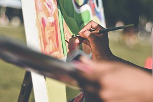 Artist with Paintbrush and Canvas