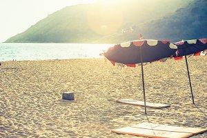Beach loungers on deserted coast