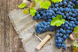 Wine and grapes in vintage setting