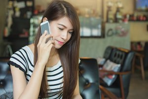 woman talking on a smart phone