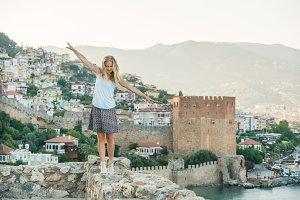 Young blond woman tourist balancing