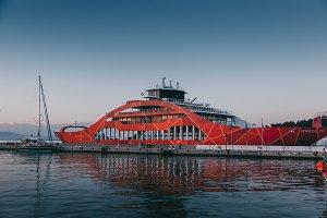 Red ferryboat docked in port