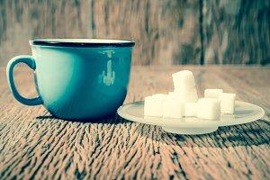 Cube sugar on wood table