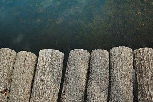 Natural wood trunk bridge