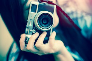 beautiful woman with retro camera