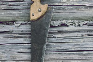 Old rustic carpenters hand saw