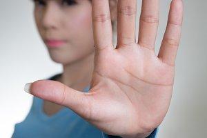 Asian women showing stop hand