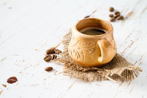 Coffee in rustic cup, copy space