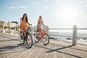 Female friends riding their bicycles