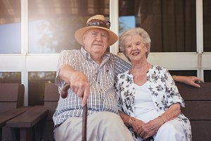 Elderly couple sitting relaxed