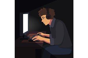 Video gamer playing at night