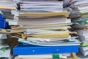 Pile of documents on desk