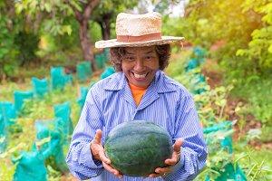Senior farmer woman hold watermelon