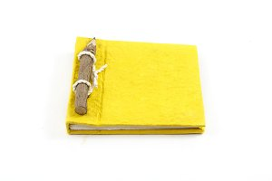 yellow notebook and pencil