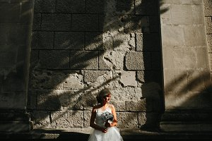 bride posing on stone wall background